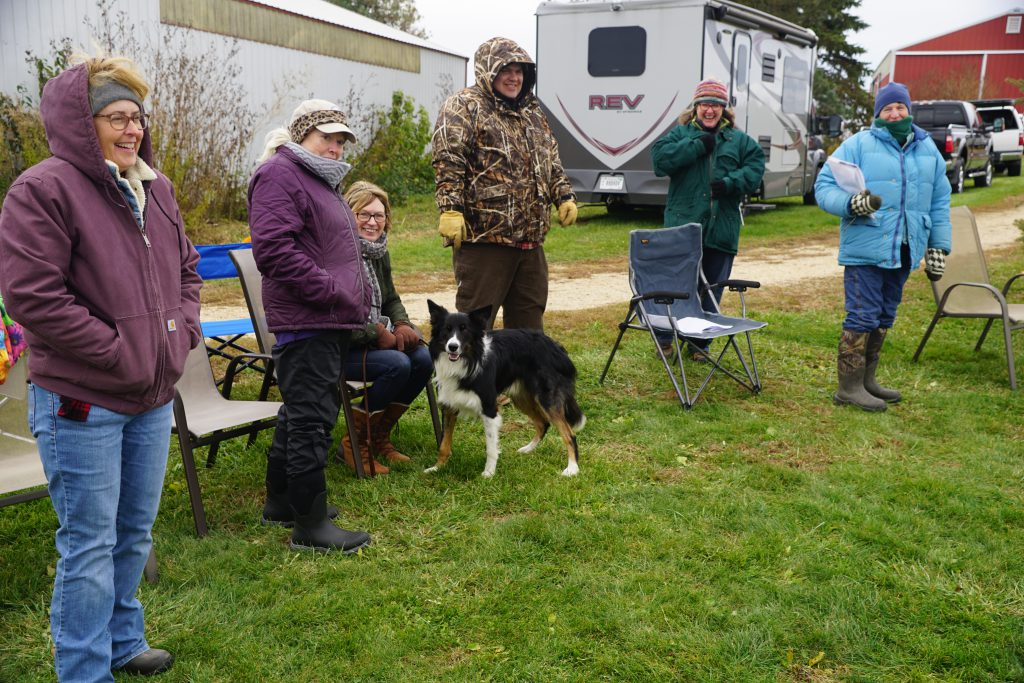 Handlers enjoy the crisp autumn day and each other--all prior to the cold rain and wind of the next day. Photo by John.